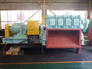 Crusher with foreign material ejection system